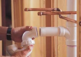 Plumber connecting PVC pipes